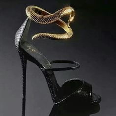 Love the idea of these Snake stilettos, will definitely need a professional stilettos walker to walk in these but find them really unique and unusual!