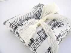 This ring bearer pillow is a perfect touch to your music themed wedding or ivory wedding. This pattern is on 100% cotton fabric. A soft ivory lace