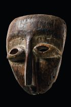 Mask, D. R. Congo, Lega  wood, stained brown patina, traces of black paint, kaolin (eye zone), eyes and nose especially accentuated: the eyes bulg...