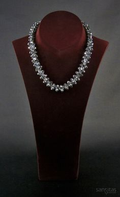 Azariel Silver - An elegant tapered crystal necklace featuring interwoven briollette. Crafted to add some sparkle to your life this eye-catching piece is versatile enough to go on day and evening wear!