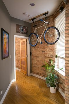 Not only does the bike look cool, but I am in love with the hallway. I love exposed brick. Really cool setup here. (via: Rachel & Brian's Spacious Place / bike storage)