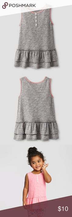 New CAT & JACK Gray Sleeveless Ruffle Tunic Perfect for summer playdates, this Tunic looks great with a colorful pair of leggings. This tunic tank top is made from comfy, breathable jersey-knit cotton rayon for extra softness.   available in size 4T | 5T condition: new without tags color: Turbine Gray  • Cotton, polyester, and rayon construction is soft and lightweight  • Ruffled skirt adds girly flair  • Sleeveless design keeps her cool  • Front button-down closure makes it easy to slip on…