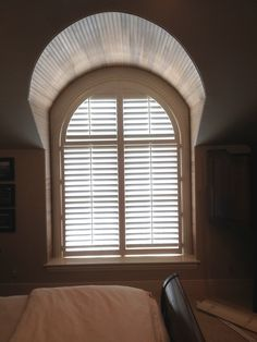 3 1/2 Inch Arched Plantation Shutters By The Louver Shop On A Bedroom Window