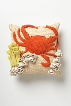 Hand-Crocheted Grotto Pillow - Anthropologie.com  Do the same, but use fabric scraps instead of knitting!