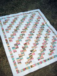 cute scrappy quilt - bricks of solid and strips ... free pattern from Miss Rosie's