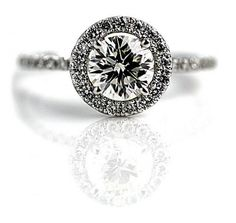 1.03 Carats 14 Kt White Gold Contemporary Round Diamond Engagement