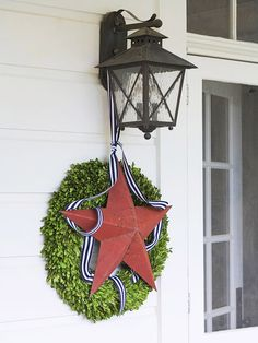 Tie a metal star to an outdoor light fixture. More fabulous 4th of July ideas: http://www.bhg.com/holidays/july-4th/?socsrc=bhgpin070312