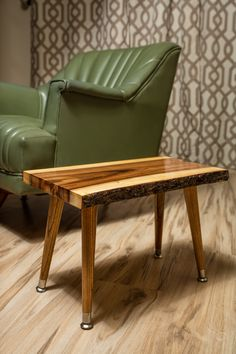 """Just finished this small mid century modern style end table. Made from 1"""" thick slab of Acacia finished with 8 coats of tung oil (smooth high gloss) and added tapered pencil legs. Measures 19x11.5x13  #acacia #liveedge #midcenturymodern"""
