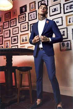 Savio De Chiara dons a trim blue suit from boohooMAN's new tailoring collection.