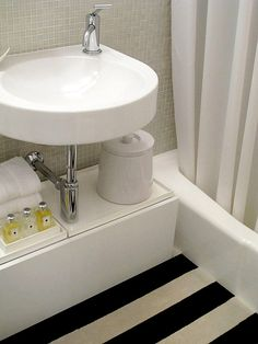 TheDesignerPad - The Designer Pad - Living In 500 Sq. Feet • The Bathroom   floating sink with floor storage