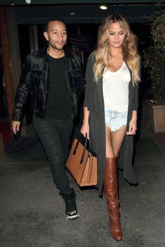 Chrissy Teigen transforms her denim shorts to nighttime chic by adding thigh high boots, a knitted duster cardigan and a white tee.
