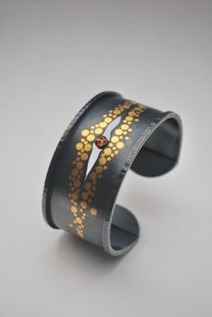 Keum Boo is a technique I've always wanted to learn. Gold and black together = spectacular! Cuff by Carolina Andersson Enamel Jewelry, Jewelry Art, Silver Jewelry, Jewelry Design, Metal Bracelets, Jewelry Bracelets, Jewelery, Bangles, Mixed Metal Jewelry