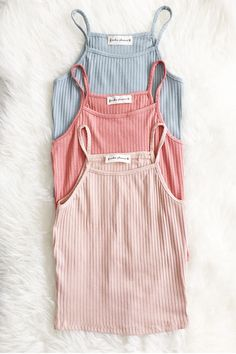 """Details Size Shipping • 96% Rayon 4% Spandex • Soft ribbed tank top • Hand Wash • Line dry • Made in the U.S.A • Measured from small • Length 14.5"""" • Chest 11."""