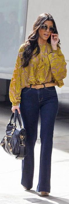 Kourtney Kardashian wearing Balenciaga Giant City Handbag J Brand The Doll Jeans in Indigo Twelfth Street Nude & Neon Embroidered Sheer Blouse