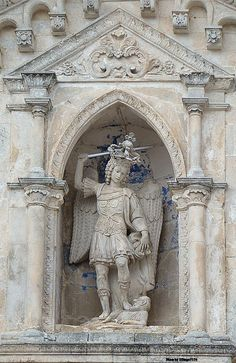 Sanctuary of Saint Michael the Archangel, Monte Sant'Angelo, Apulia, Italy. Statue of the Saint overlooking the main entrance. Saint Michael, Region Normandie, Sacred Mountain, Mont Saint Michel, Southern Italy, Chapelle, Place Of Worship, Heritage Site, Barcelona Cathedral