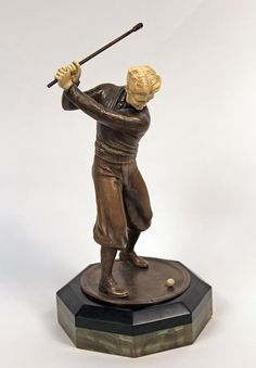 A cold patinated bronze and hand carved ivory sculpture by Prof. Otto Poertzel entitled Golfer. The piece seats in a black marble and onyx base. Made in Germany Circa: 1930
