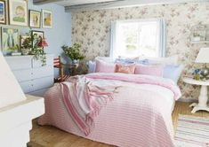 soft floral wallpaper when combined with pastel pink and blue bedding.