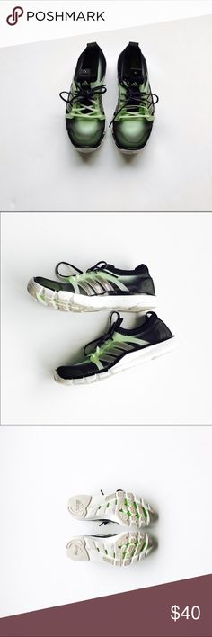 Adidas size 7.5 Training Sneakers Adidas Trainers. Black and yellow to green in color. Have no separate tongue. Slip your foot into the sneaker and lace up to tighten. Barely worn. Size 7.5 and fit true to size Adidas Shoes Sneakers