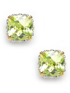 Oversized glass stud earrings in a feminine hue are the prettiest understated accent. Glass cushion cut stones in a rich peridot hue are set in a gold-tone base.