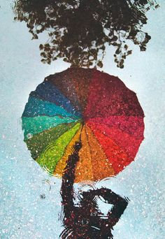 rainy days Rainy by mattias tyllanderRainy capture by Mattias Tyllander - I love these colourful illusions that bring out the cheer in the world on what at first seen as a dreary day.Rainbow umbrella in the rainThis photo won Sweden& edition of Metro Rain Photography, Umbrella, Art Photography, Photography, Painting, I Love Rain, Art, Pictures, Reflection Photography