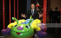 Jeff Koons poses beside one of his artworks at the opening of a contemporary art exhibition at the 'Garage' gallery on March 19, 2009 in Moscow, Russia.