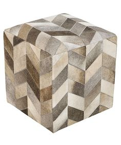 Trail Leather Chevron Pou: A graphic, architectural piece despite the softness of its outline, this Trail Leather Chevron Pouf has been expertly hand-pieced in India, the multiple shades of grey, white, tan, and taupe hides coming together into a dynamic neutral pattern with a distinctive sense of movement. The upscale end of casual furnishings, this pouf is a striking home accessory.