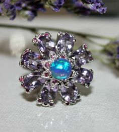 """Beautifull Flower"" Silver ring with opal, amethyst, ruby Sold by Jewellry 175,00 $"
