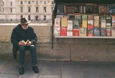 Bookseller reading in Paris  https://www.pinterest.com/aasheeshpittie/books-libraries-and-readers/
