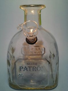 Bottle Heaven's handmade up-cycled bottle art. View the product description for more info on the brand and item type. bottle crafts Patron Silver Liquor Bottle Water Pipe - Custom Hookahs, Lamps, Glass Tumblers, Custom Candles & More. Patron Bottle Crafts, Alcohol Bottle Crafts, Alcohol Bottles, Wine Bottle Crafts, Patron Bottles, Wine Bottle Art, Diy Bottle, Bottle Bong, Glass Bottle