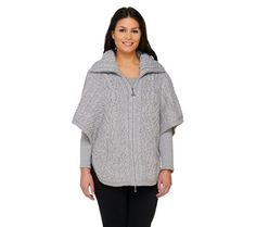"""Aran Craft Merino Wool Zip Front Cape.Hardware: double zip front closure Features: shawl collar, front side pockets, side button closure Fit: relaxed fit; generously cut for maximum wearing ease Length: missy length 28"""" to 30""""; plus length 30"""" to 30-1/2"""" Content: merino wool Care: dry clean only."""