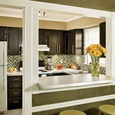 Warm brown paint, glass mosaic tile, and fresh fixtures update a drab old kitchen.   Before.      After.      With kitchens, simple does not necessarily equal streamlined. For homeowners Eduardo Perez and Moo Sirikittisup, the kitchen that came with their Atlanta condo fell short on both frills and...