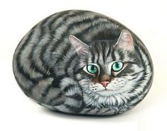 Cat painted on a stone