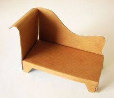 a great tutorial on how to make your own Cardboard Cat Chaise.