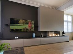 living room elements as cabinetry adds utility in a sleek way