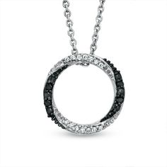 I've tagged a product on Zales: Enhanced Black and White Diamond Accent Twist Circle Pendant in Sterling Silver