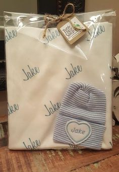 Personalized Newborn Swaddle Blanket and Embroidered newborn hat. 100% organic cotton knit Baby Blanket. Personalized Name Blanket. Newborn Blanket and Baby Name Hat gift set. Your precious newborn will stand out with his or her very own personalized Blanket and baby name hat! This swaddle blanket and hat combo makes the perfect gift! The babys name can be embroidered on a heart, circle or square. If you want something other than a heart please let me know at checkout in notes to seller…