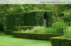 The Geometric Garden is lined with yew hedges and filled with perennials.