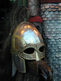 Rohirrim helm created by WETA Workshop for LOTR. This helmet and vambrace was hand forged, complete with the traditional Horse motif of Rohan. (via pacalin)