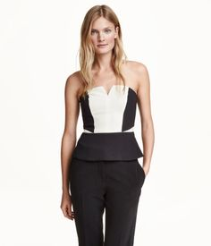 Color-block, strapless top in woven fabric with concealed silicone trim inside upper edge. Concealed back zip, seam at waist, and a gently flared peplum hem. Lined. | H&M Modern Classics