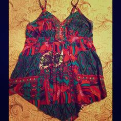 Sweet Boho Colorful Tank FINAL PRICE Brand is Cato. Very colorful and night for spring or summer. Darling sequin detail in front.  Handkerchief hem. In the photo I am a 34c and a size small to medium shirt and this is very big on me. Cato Tops Tank Tops