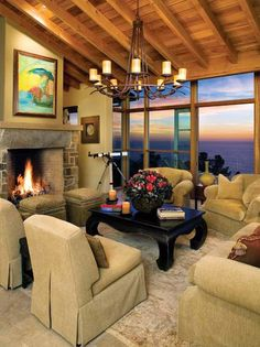 elegant ethnic living room | Ethnic and Old World Decorating Ideas.  Good ottomans in front of the fireplace