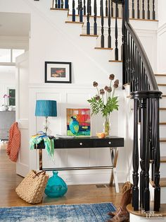Front Entry - Foyer has dramatic black balusters gives a sophisticated edge to traditional bones on the stairway.