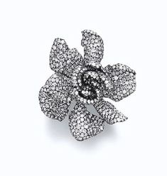 A DIAMOND GARDENIA RING, BY JAR.  Sculpted gardenia blossom, pavé-set in diamonds, mounted in silver and gold.