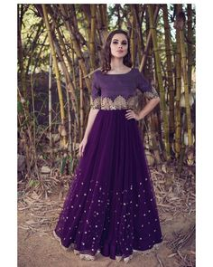 Beautiful wine color designer leheng and blouse with hand embroidery work from Meenakshi collection of Mrunalini Rao . Photography by Akshay Rao. Indian Gowns Dresses, Pakistani Dresses, Bridal Dresses, Indian Designer Outfits, Indian Outfits, Designer Dresses, Lehenga Designs, Simple Gowns, Party Kleidung