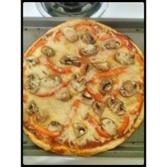 This was SO GOOD! We (my friend, fiance and myself) used a whole grain crust, and topped it with tomato sauce (lightly), lowfat cheese, mushrooms, and red bell pepper...