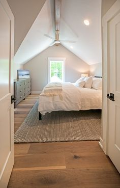 Guest Bedroom of Tall Cedar House Plan. This modern farmhouse floor plan is 1930 sq ft and has 3 bedrooms Guest Bedroom of Tall Cedar House Plan. This modern farmhouse floor plan is 1930 sq ft and has 3 bedrooms, bathrooms, floors, and a 2 car garage. Attic Master Bedroom, Attic Bedroom Designs, Attic Bedrooms, Upstairs Bedroom, Bedroom Loft, Guest Bedrooms, Home Bedroom, Modern Bedroom, Bedroom Storage
