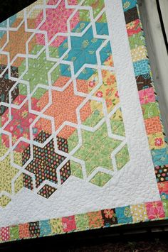 the white star shape dominates over the tumbling block. This quilt is forgiving because the points that don't quite meet are hidden since it is all one fabric!