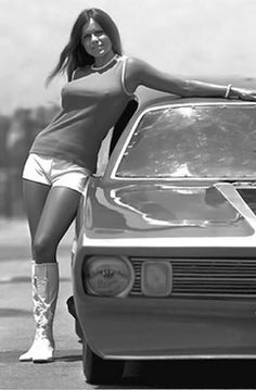 Hot pants and go-go boots were all the rage in the 70's and this young lady is perfect for that outfit. Do you think she would race you for pink slips???