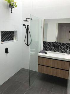 Floating timber vanity with black tapware wash plane sink, tile niche with black hexagon tiles Bathroom Feature Wall, Bathroom Niche, Oak Bathroom, Bathroom Renos, Bathroom Renovations, Feature Tiles, Bathroom Inspo, Hexagon Tile Bathroom, Bathroom Splashback