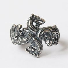 Celtic wolves heads ring  Production technology: casting Material: Silver plated brass Size: 7 US or 17,5 mm  Payment: PayPal or Direct Checkout